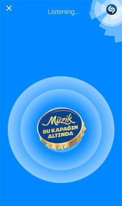 Shazam logo alanında Müzik Bu Kapağın Altında ile kullanıcılara müzik keşfetme deneyimi sunuyor.